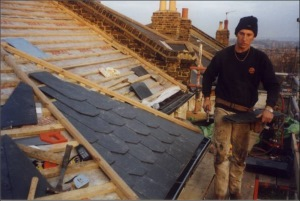 New slates being scalloped to match the original Victorian roof covering